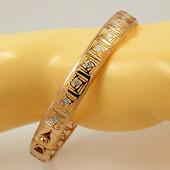Жёсткие золотые браслеты обручи